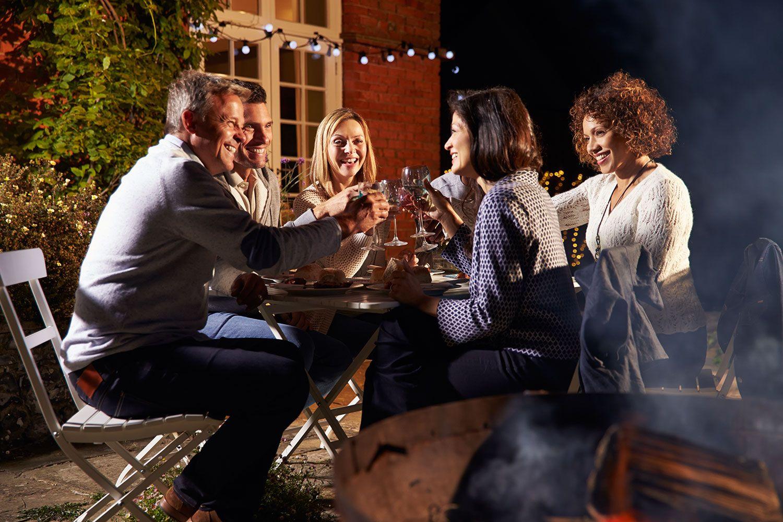 Group of friends enjoying dinner outside